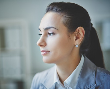 head collar: Young businesswoman with calm expression