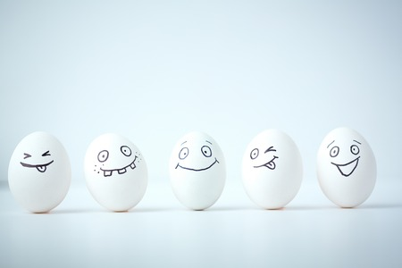 Line of Easter eggs with different facial expressions