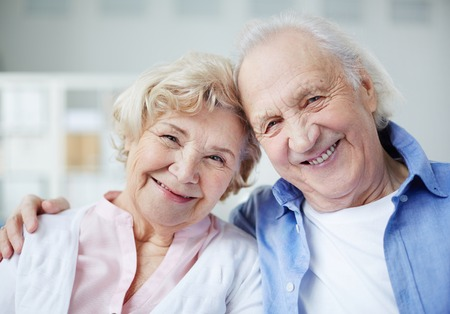 Portrait of senior couple looking at camera with smiles Banco de Imagens