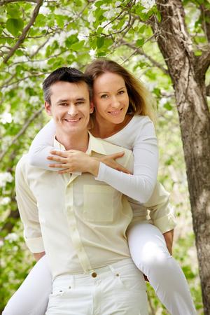 Portrait of happy couple having fun in park