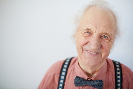 Portrait of a happy senior well-dressed man looking at camera