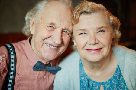 festive occasions: Portrait of retired couple in smart clothes looking at camera Stock Photo