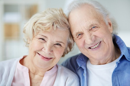 Portrait of senior couple looking at camera with smiles Stok Fotoğraf