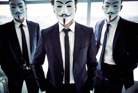 alike: Portrait of three masked guys with attitude