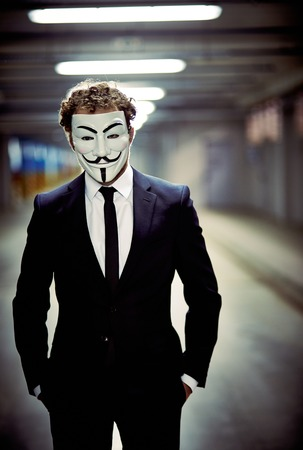 guy fawkes: Vertical portrait of a business guy staring from behind anonymous mask