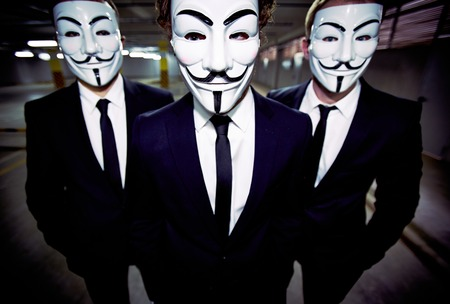 uniform attire: Close-up portrait of a group of people of the uniform appearance wearing Guy Fawkes masks Editorial