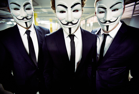vendetta: Portrait of a group of businessmen wearing Guy Fawkes masks