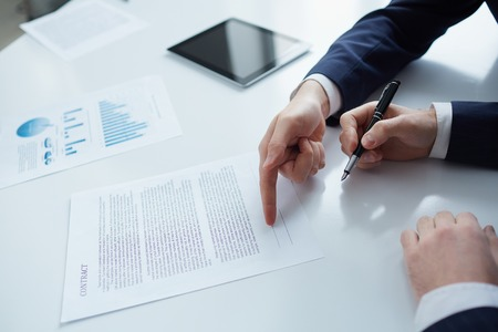 business contract: Two businessmen while signing a contract Stock Photo