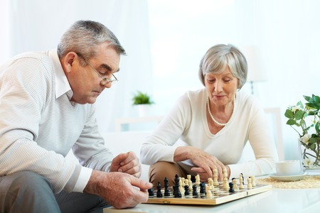 chess player: Senior couple playing chess