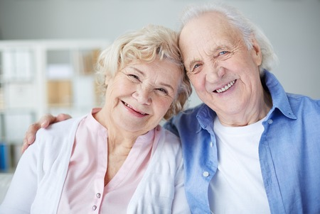 an elderly couple: Portrait of cheerful seniors looking at camera with smiles