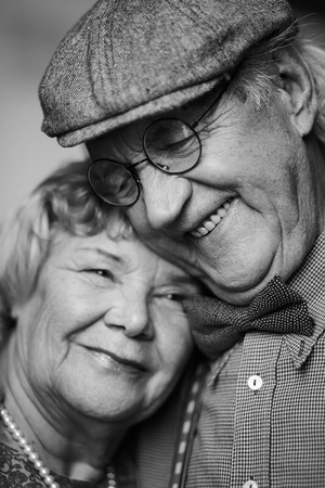 old family: Black-and-white image of senior couple in smart clothes
