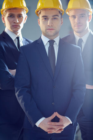 chairman: Vertical portrait of a business leader leading his team