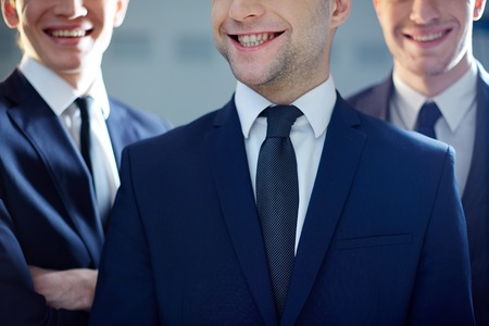 cropped image: Cropped image of a ceo grinning from ear to ear being on the foreground