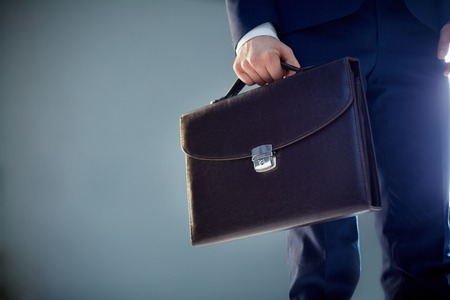 Isolated image of a businessman carrying a briefcase  photo
