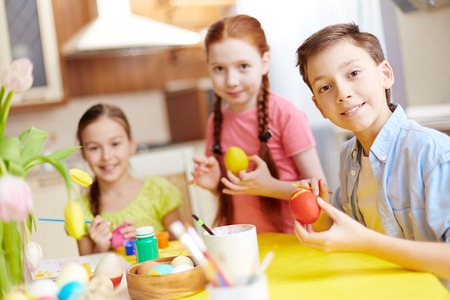 Children painting Easter eggs at school photo
