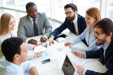 focus group: Group of business partners communicating at meeting in office