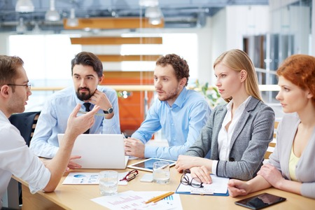 team leader: Image of a serious business team at the meeting  Stock Photo