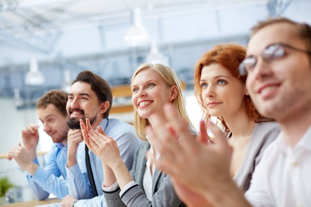 Image of a business team with its leader being at the conference on the foreground  Stock Photo