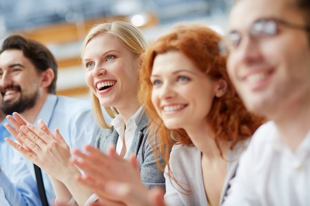 Image of a business team applauding in the sign of approval Stock Photo