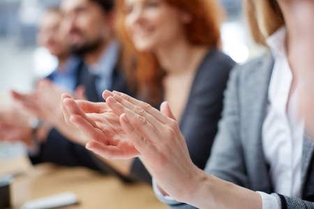 clapping hands: Cropped image of a businessperson applauding on the foreground  Stock Photo