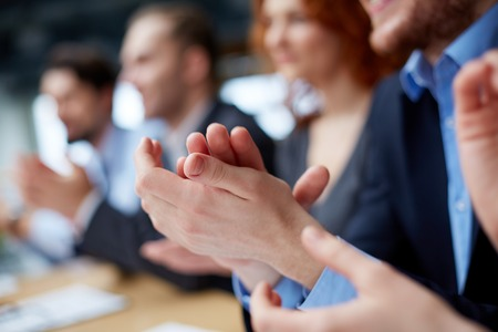 success focus: Photo of business partners' hands applauding at the meeting