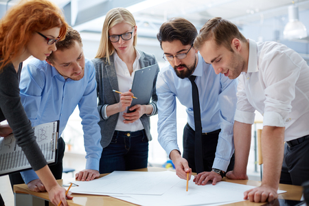 developing: Business team developing plan together at the office  Stock Photo