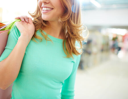 shopaholism: Close-up of smiling girl with shopping bags Stock Photo