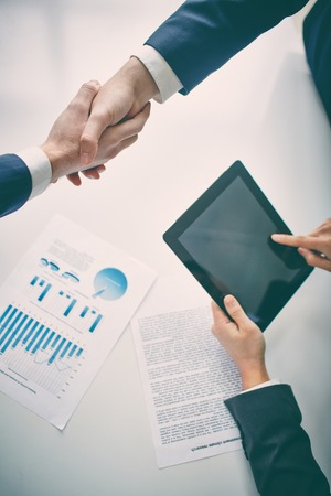 integrity: Managers shaking hands upon agreement Stock Photo
