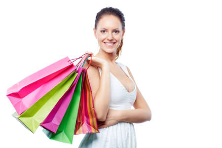 shopaholism: Portrait of happy female with shopping bags over white background