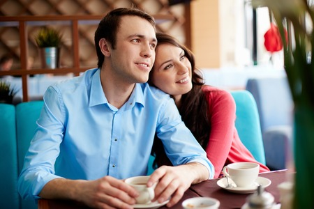 inlove: Portrait of amorous young couple relaxing in cafe