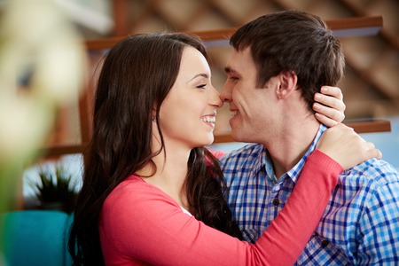 Portrait of amorous young couple looking at one another Stock Photo