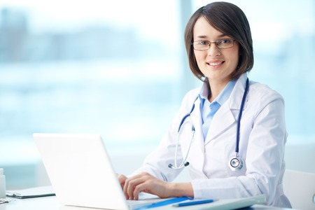 Portrait of a smiling physician working in her office Stock Photo - 27241773