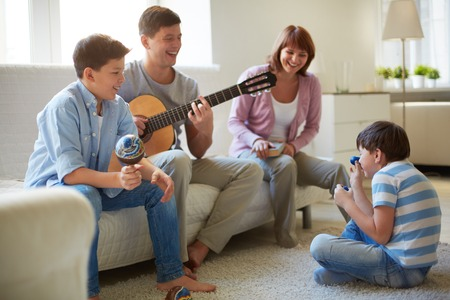 Portrait of happy family of four having fun at leisure