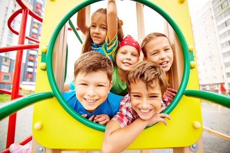 Image of joyful friends having fun on playground outdoors  Zdjęcie Seryjne