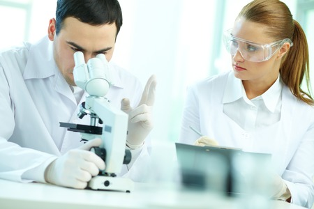 Serious clinicians studying chemical elements in laboratory Stock Photo - 27697310