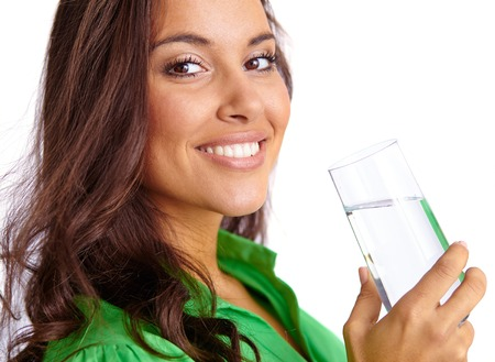 Close-up of pretty girl with glass of water looking at camera photo