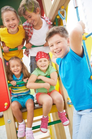 Image of joyful friends having fun on playground outdoors  photo