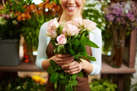 Close-up of female holding bunch of pink roses photo