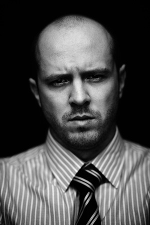 serious guy: Vertical portrait of serious guy looking at camera