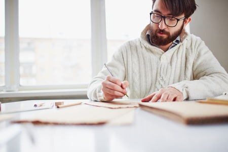 busy beard: Image of young man drawing with ballpoint