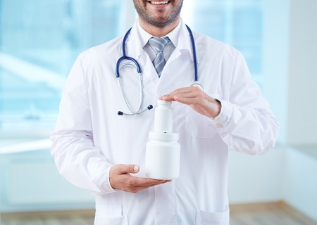 new medicine: Close-up of doctor holding new medicine
