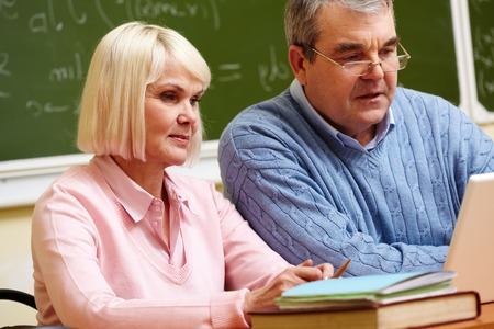 Elderly people using modern technologies for studying Stock Photo - 28331886