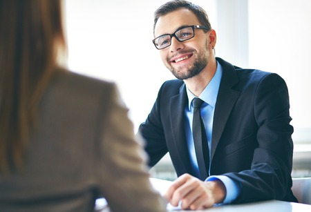 employer: Image of young businessman interviewing female