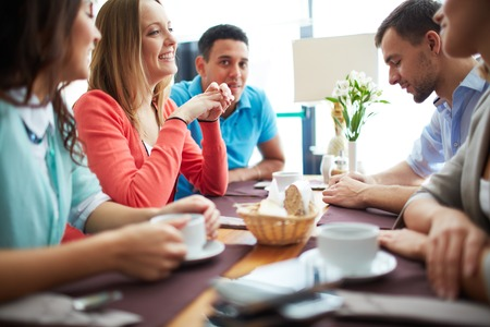 focus group: Portrait of happy teenage friends sitting in cafe Stock Photo