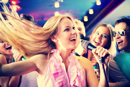 Portrait of joyous girl singing  photo