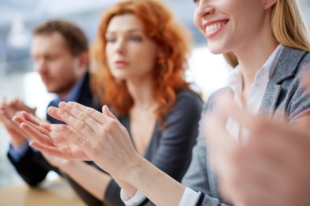 people clapping: Photo of business people hands applauding at conference Stock Photo