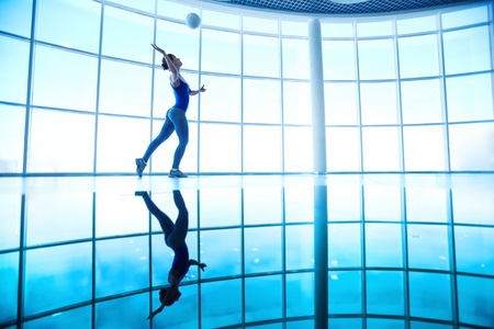 Young female playing with ball in gym  photo