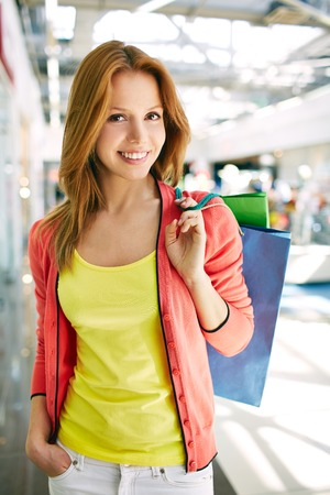 shopaholism: Portrait of happy girl holding shopping bags Stock Photo