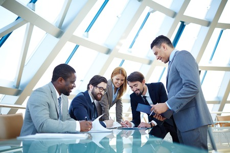 partner: Group of business people discussing data or planning work at meeting