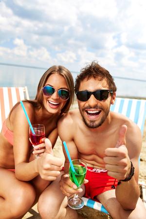 Joyful couple having fun at party on the beach photo